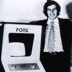 """Nolan Bushnell with his new game called """"Pong"""" - 1972"""