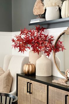 Add the perfect finishing touch to your fall styling with a few artificial Japanese maple leaves. Simply trim their stems down to fit your favorite vase and enjoy the look of fall without the fuss. Shop artificial fall leaves at Afloral.com. Image by @greybirchdesigns.