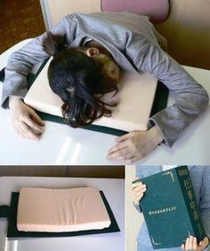 Dictionary Desk Pillow - This hidden gem makes lunch time naps a breeze   Via GeekAlerts.com