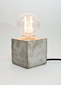 LJ Lamp alpha - concrete table lamp with textile cable - Made in Berlin by LJLamps on Etsy https://www.etsy.com/listing/195445986/lj-lamp-alpha-concrete-table-lamp-with