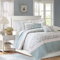 For the stylish, modern room, Dawn holds all of the perfect elements to do shabby chic the right way. A mixture of soft blue, periwinkle, and hints of green are printed in a paisley design alongside pintucked blue fabric that is separated by lace taping. Three decorative pillows with pleating, embroidery and ruching details complete this look.