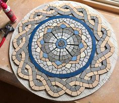 Morning everyone! The guilloche pattern on the Roman mosaic design table is now finished - onto the border next - how do you think it is coming on? Mosaic Tile Table, Mosaic Pots, Mosaic Wall, Mosaic Glass, Mosaic Table Tops, Mosaic Stepping Stones, Stone Mosaic, Pebble Mosaic, Mosaic Crafts