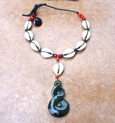 Beautiful B.C. Jade and Cowrie Shell Drop by KipajiPraiseJewelry