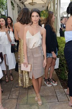 The model attended Net-a-Porter's luncheon in a silk tank and skirt, which she finished with Brian Atwood h...
