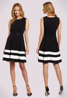 """Black and White Dress. If you'd like to channel a little """"Mad Men"""" flair into your wardrobe, this dress is the perfect option. The neutrals give it a professional tone, but the fuller skirt and high neckline give it a 60's vibe. Pair with classic heels, a blazer and simple accessories for a truly stand out look!"""