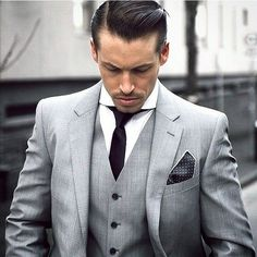 Not a fan of the hairstyle, but the three-piece look is lovely. Maybe spice it up with some color; I'm thinking blue and red striped tie, with a red pocket square.