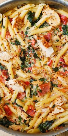 Chicken and Bacon Pasta with Spinach and Tomatoes in Garlic Cream Sauce – delicious creamy sauce perfectly blends together all the flavors: bacon, garlic, spices, tomatoes.  Use gluten-free brown-rice penne pasta!