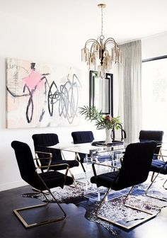 Black dining space with graphic modern art.: