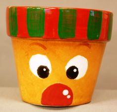 Paint your own pottery.  This Christmas Rudolph flowerpot was painted using underglazes.