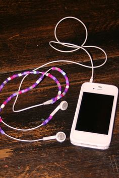 not sure how you get the pearler beads onto the headphones, but a great idea, keeps them from tangling or, even better, getting torn or chewed!