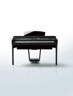 Yamaha Clavinova CVP-609 digital piano in a polished ebony finish.