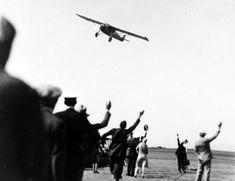 (1927) - Charles Lindbergh in his Spirit of Saint Louis preparing to land as spectators waive. near LA