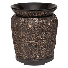 Interlaced copper vines entangle a bronze-finished vessel with vineyard flowers and leaves