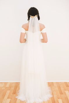 14. Say I do in this english net wedding veil from NoonOnTheMoon. The tulle is lightly gathered for a sleek, elegant bridal look just for you. Shop NowNoonOnTheMoon