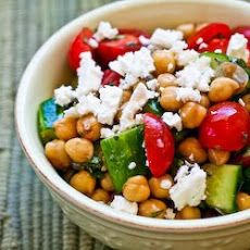 Cucumber and Tomato Salad with Marinated Garbanzo Beans, Feta, and Herbs Recipe Salads with garbanzo beans, cucumber, diced tomatoes, balsamic vinegar, extra-virgin olive oil, fresh oregano, salt, ground black pepper, feta cheese crumbles