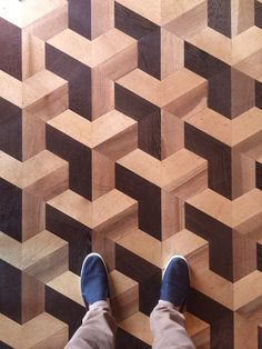 The illusion of 3D in 2D masterfully created and used as the design for a parquet floor.