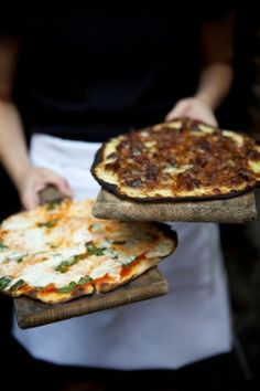 Pizza on old wooden boards