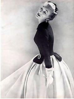 Model wearing a white satin skirt with a black taffeta jacket, 1951. Photo by Richard Avedon. by Melissa141