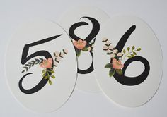 Floral accented table numbers
