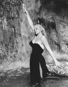 La Dolce Vita! Think she took off her jewelry before taking a swim in the Trevi?