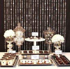Love the crystal curtain as a backdrop/ This treat table is 'sweet' and simple.