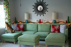 living room layout - I like the sofa table and footstools