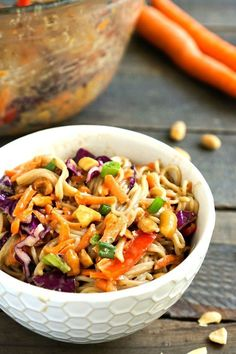 This peanut ramen noodle salad is a healthy, delicious recipe for lunch or dinner. It also makes a wonderful side dish at a potluck meal. Gluten-free, vegan recipe from via Potluck Recipes, Healthy Salad Recipes, Whole Food Recipes, Healthy Potluck, Healthy Lunches, Free Recipes, Gluten Free Ramen Noodles, Ramen Noodle Salad, Food Dishes
