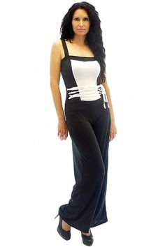 Women jersey jumpsuit. The jumpsuit is in two colors - black and white. The model is with thick black straps. The trousers are with free cut. The jumpsuit is with small ties decorating the waist.