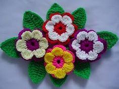 Passo a passo desta linda flor em crochê, que pode ser feita em lã, linha ou barbante, ótima para aplicação em tapetes , bolsas, almofadas ...