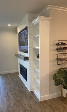 Electric fireplace with shiplap and wall mounted tv Fireplace With Shelves, Built In Around Fireplace, Built In Electric Fireplace, Wall Mounted Fireplace, Tv Over Fireplace, Basement Fireplace, Fireplace Built Ins, Bedroom Fireplace, Farmhouse Fireplace