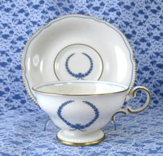 Tea Cup And Saucer Castleton USA Empire Blue Wreath Burnished Gold Trim 1950s