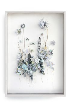 Flower Constructions are 3-D collages from pressed flowers and cut out flower pictures. Each element is meticulously placed on pins which creates the depth. Some of them are like a fantasy Herbaria, filled with dried flowers or branches, with irregular shapes and sophisticated twists and some refer to planets.