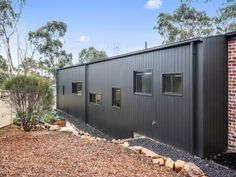 Weathertex's Weathergroove vertical timber cladding panels have a unique capacity to clad large spaces rapidly due to their size.