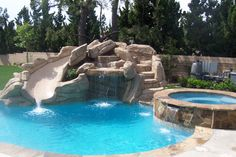 pool-designs-with-slides-Pool-Traditional-with-Carribean-Blue-Colorquartz-construction.jpg (938×626)