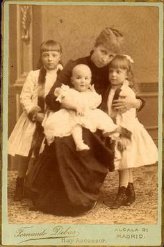 Queen Regent María Cristina of Austria in mourning for Alfonso XII with her three children: the Princess of Asturias, the Infanta Teresa and the King of Spain, baby Alfonso XIII.