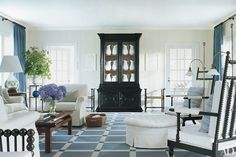 A French ebonized cupboard holds center stage in the Thad Hayes–designed living room of a Southampton, New York home featured in Architectural Digest in Photo: Scott Frances Architectural Digest, Hamptons Living Room, Beach Living Room, Coastal Living, Luxury Living, Belle Lingerie, Clarence House, Slipcovers For Chairs, White Rooms