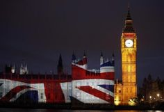 The Union Flag, commonly known as the Union Jack, is projected on the Palace of Westminster next to Big Ben on the bank of the River Thames, before the London 2012 Olympic Games July 27, 2012.