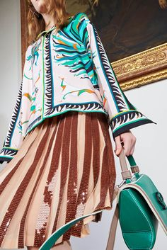 The World of Pucci: ready-to-wear, handbags, shoes, eyewear and much more.