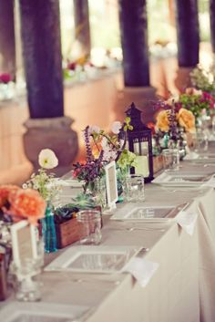 Basically how I want my centerpieces, with lanterns, flowers, candles. But with some books and maybe a birdcage. Hahaha. Lots of stuff, but I'll make it work. The tables will be round, though.