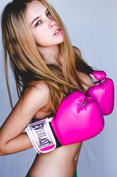 Girls doing idiotic sh*t with boxing gear. The glove bra.