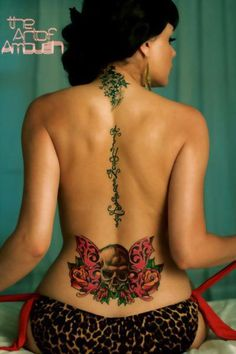 i love the placement for her spine tattoo. in the middle is so perfect