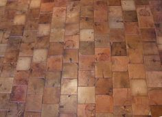 These are end grain squares from reclaimed timber beams used for cobble block flooring.