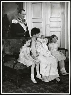 Nordic love.  Crown Prince Olav of Norway looks on adoringly at his family, now complete with the birth of the heir, Prince Harald.