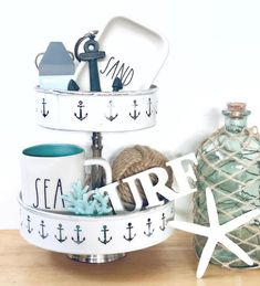 Tiered Tray with a Nautical Theme Tabletop Decor Ideas - Using tiered trays for nautical and coastal theme displays. Featured on Completely Coastal. Style y - Coastal Style, Coastal Decor, Coastal Living, Coastal Interior, Coastal Cottage, Coastal Homes, Lake Decor, Beach Design, Nautical Theme