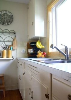 how brilliant is it to hang bananas from a big under-counter hook??  I could get rid of the banana hanger thing on the counter! by jami