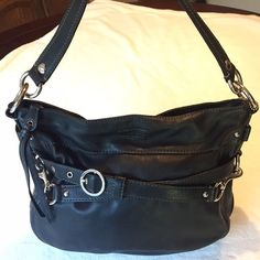 Authentic Coach purse, cross body Soft supple black leather authentic coach handbag seeking new home. This has been my trusty go-to for awhile now but I'm ruthlessly emptying the closet. Although lovingly used, this bag shows some wear. There are a few small white paint marks in the inner lining (inside the purse) and some normal wear along the leather near the main zipper enclosure. Photos included. 13x10x3.5in.  The black strap shown buckled midway through the bag, is the long shoulder…