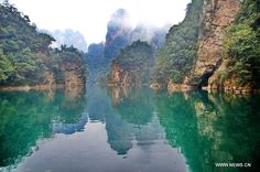 Photo taken on Feb. 2013 shows the scenery of the Baofeng Lake scenic spot in Zhangjiajie City, central China's Hunan Province. Beautiful Scenery, Beautiful Places, Traveling By Yourself, Sky People, Zhangjiajie, Lighthouse, Ocean, River, Nature