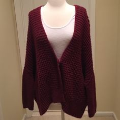 Free People oversized cardigan 35% acrylic, 33% polyester, 27% wool, and 5% angora rabbit hair. Good condition. One snap closure. Free People Sweaters Cardigans