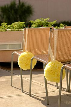 We made tissue paper pomanders for the ceremony decorations Read more at http://thebudgetsavvybride.com/adorable-yellow-wedding/#cfo3YlSJMGY8dirI.99