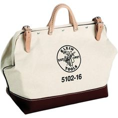 Perfect toting farmers' market finds or stowing garden tools, this classic canvas tool bag showcases leather handles and a water-resistant base.